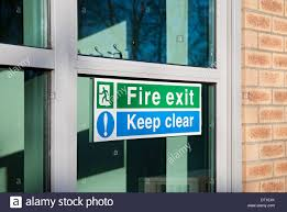exit and keep clear signs on glass door uk united