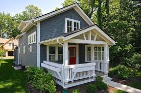 country cottage style house with boxwood and picket fences comfy