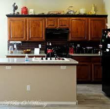 Traditional Dark Wood Kitchen Cabinets Glorious White Marble Countertops Also White Sliding Windows