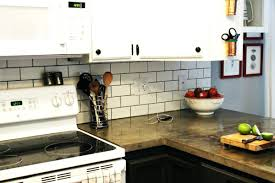 how to install a kitchen backsplash diy kitchen subway tile backsplash asterbudget
