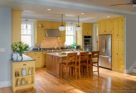 yellow kitchen wood cabinets traditional yellow kitchen with a custom wood island