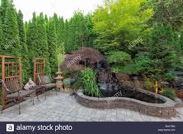 rock garden pond waterfall shrubs stock photos u0026 rock garden pond