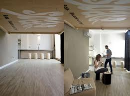 space saving bed raises to become ceiling art by renato arrigo
