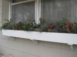 Christmas Decorations For Window Boxes by 5 Ways To Decorate With Pine Boughs