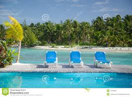 beach bungalows on tropical pacific ocean island stock images