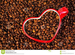 heart shaped coffee mug with beans royalty free stock images