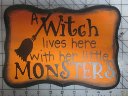 a witch lives here with her little monsters halloween wood sign