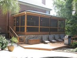 rock hill screened porch leading down to composite deck screened