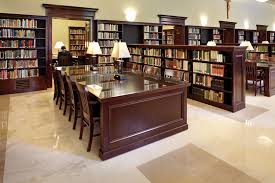 astonishing home library design with dark brown wooden finished of