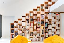 bookshelf house fits hundreds of books into multifunctional