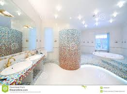 two sinks and big mirror in spacious bathroom with jacuzzi stock