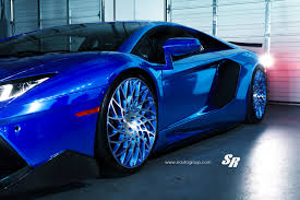 lamborghini urus blue electric blue aventador gets outrageous pur disc style alloys