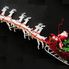 vintage santa and six reindeer sleigh from like us vintage