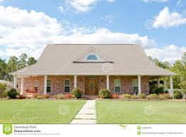 Rambler House by Brick Yellow American Rambler House Royalty Free Stock Photos