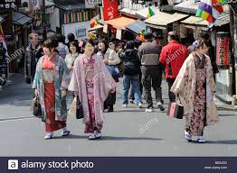young people in kimonos in the old town walking to the kiyomizu
