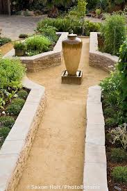 stone raised bed vegetable beds in california front yard garden