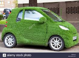 smart car smart car covered in artificial grass in street london uk stock