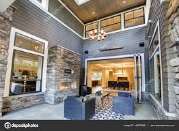 gorgeous covered patio boasts high ceiling with skylights u2014 stock