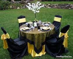 black chair sashes yellow black and white color palette embroidery table overlays