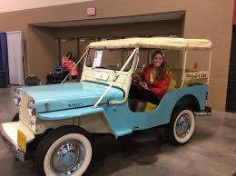 peach jeep the jeep girls celebrate 75 years of jeep in toledo fca north