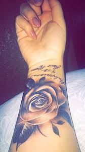 cool black ink rose tattoo on right forearm
