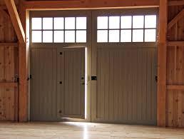 custom door design spanish cedar split slider w passage spanish cedar carriage door