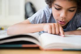 Student At Desk by Reading Motivation Activities For Elementary Students