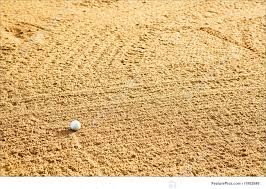 sports and recreation golf ball in bunker stock picture