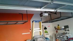Garage Ceiling Storage Systems by Las Vegas Overhead Storage Bigfoot Garage Cabinets Of Las Vegas