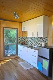 modern cabin dwelling plans pricing kanga room systems a modern and modular 14 x 24 cabin from kanga room systems