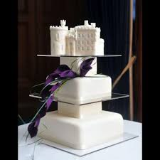 dalhousie castle wedding cake with a cake topper of dalhousie