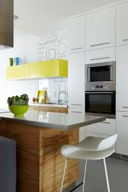 small kitchen clever set up variants tips for the best use of small kitchen four color wood white yellow accent