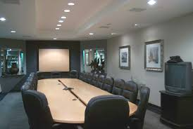 conference rooms style design with oval cream wooden table and