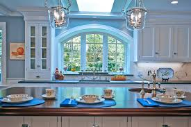 double pendant lights over sink traditional kitchen traditional kitchen with arch window skylight elements of design