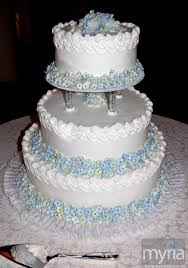 white wedding cake with little blue flowers myria