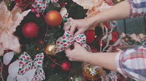 decorating christmas trees hands decorated christmas tree using
