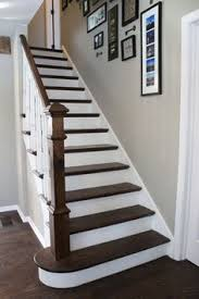 dark wood stairs and white risers on stairs with dark stained wood