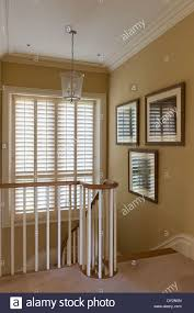 glass lantern on staircase landing with banister and window blinds