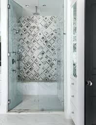 boasts seamless glass shower doors opening to gray marble