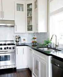 White Kitchen Cabinets And Black Countertops White Kitchen With Black Countertops Home Interior Pinterest