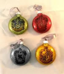 set of 4 harry potter themed baubles which include one gold