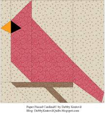 debby kratovil quilts cardinals all through the year paper