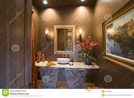 sconces and mirror over bathroom sink stock photos image 33909583