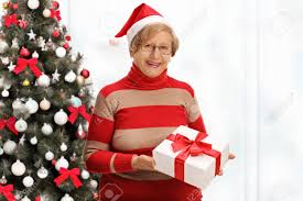 what to get an elderly woman for christmas joyful elderly woman holding a christmas present in front of