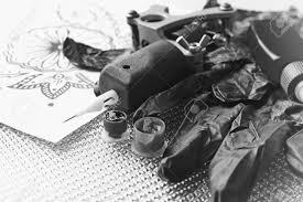 tattoo gun sketch tattoo machine sketch and tattoo supplies close up retro