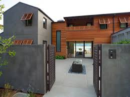 exterior color palette cool gray stucco blends with warm wood