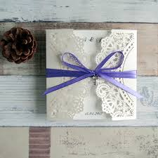 lavender wedding invitations ivory laser cut wedding invitation with lavender ribbon