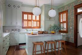 white kitchen cabinets wood trim see the hues in this charming kitchen