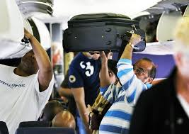 carry on fee should airlines charge for weight of carry on bags chicago tribune