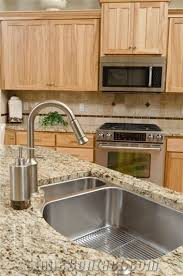 giallo ornamental granite countertop with stainless steel